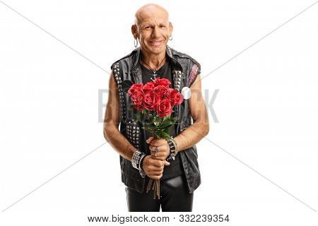 Cheerful punker holding red roses and smiling isolated on white background
