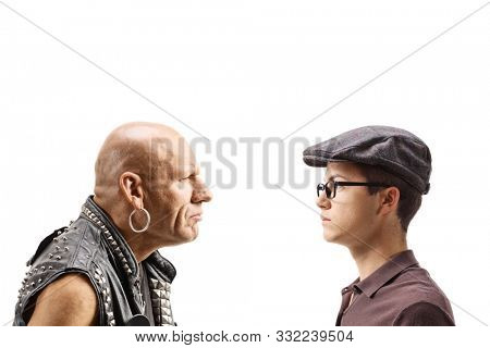 Angry punk looking at a young boy isolated on white background