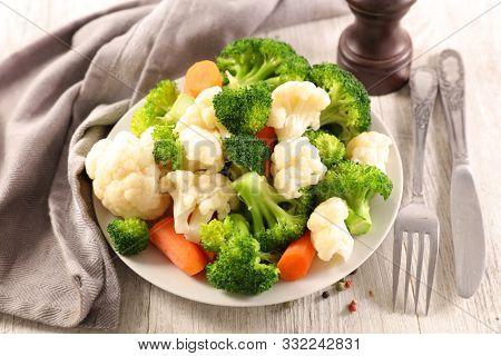 cauliflower, broccoli and carrot- vegetarian meal