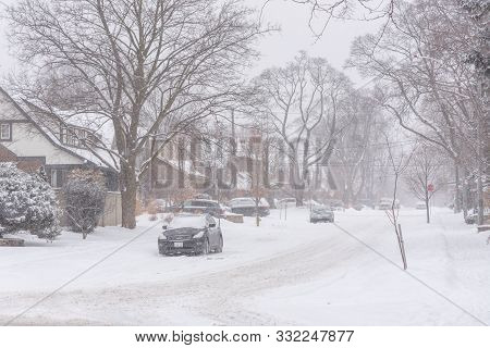 Streets And Trees Covered With Snow During Winter Snow Storm In Toronto In February