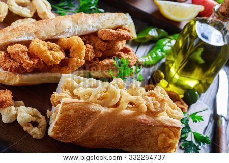 Close-up Of Sandwiches With Calamari Rings, Bocadillos De Calamares, Fresh Bread Roll Filled With Sq