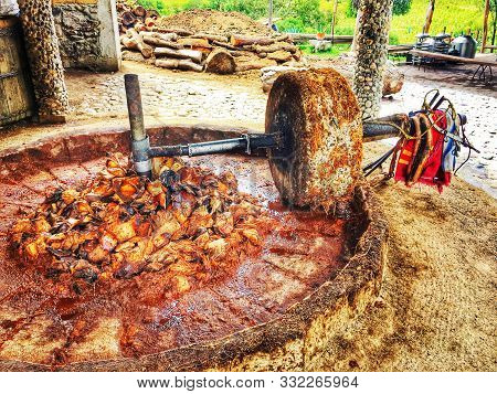 Grinding Stone For Mashing Agave To Make Mezcal In Oaxaca, Mexico