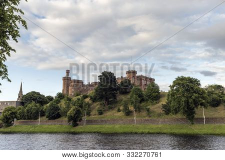 Inverness Castle On An Embankment Above The River Ness At Inverness