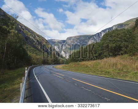 Winding Road E136 With Mountain Massif Trolltindene, Troll Wall Trollveggen, The Tallest Vertical Mo
