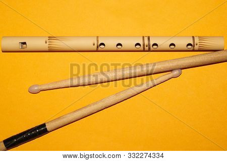 Bamboo bansuri flute and drumsticks. simple music instruments poster