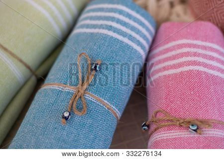 Rolled Stylish Comfort And Colourful Blankets Stored On Top Of Each Other. Rolled Blankets In A Blan