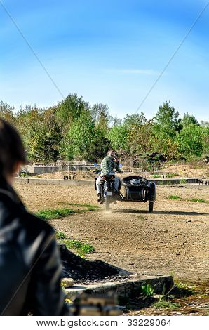 Stylish Man On A Motorcycle Leaves The Chase