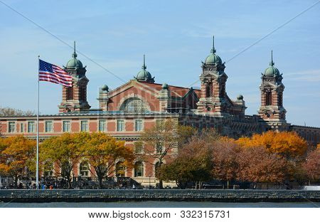 NEW YORK, NY - 04 NOV 2019: The Main Building at Ellis Island National Museum of Immigration seen from the Hudson River.