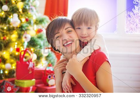 Happy Family And Merry Christmas. Mother And Baby Son At Christmas Morning At Tree Decorating And Ch