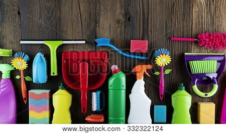 Autumn House Cleaning Theme.  Colorful Cleaning Products On Rustic Wooden Table. Top View Shot. Plac
