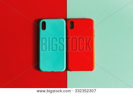 Two Silicone Cases For Your Smartphone. Colorful Silicone Cases For Your Smartphone On Light Backgro