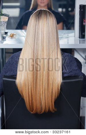 Beautiful long hair. Woman in salon