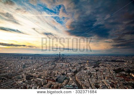 Skyline of Paris with Eiffel Tower at sunset in Paris, France. Eiffel Tower is one of the most iconic landmarks of Paris.