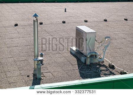 Air Conditioning System Assembled On Top Of A Building. Air Vents On Top Of Commercial Building. Air