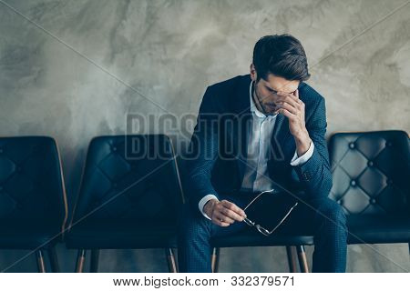 It Is Fail. Portrait Of Sad Upset Frustrated Businessman Sit On Chair Touch Nose Fingers Have Headac