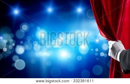 Close Up Of Hand In White Glove Open Red Velvet Curtain To Stage