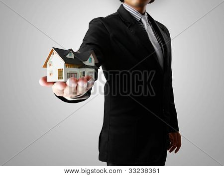 Businessman,house in human a hands