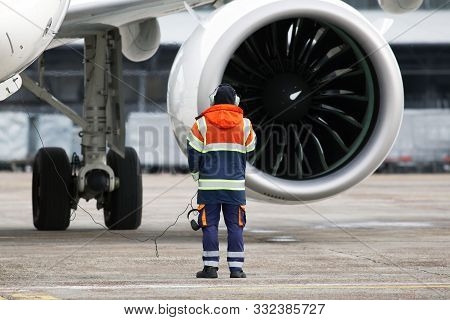 A Ground Control Manager Controls Start Turbofan Engine Process Before Aircraft Departing