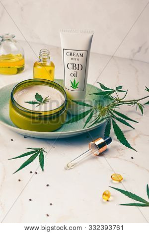 Cosmetics Cbd Oil On A Turquoise Plate On A Light Marble Background. Copy Space, Mockup.