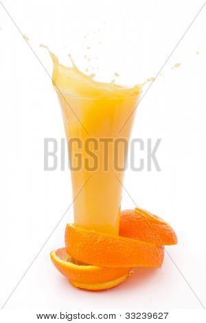 orange peel surrounded around a overflowing glass  against white background