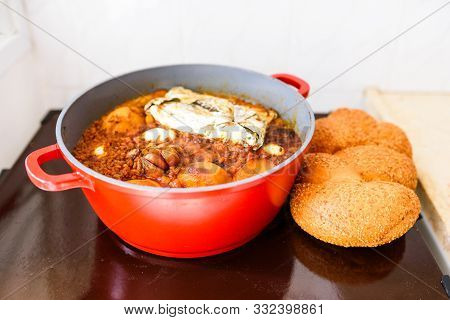 Hot Plate For The Sabbath, A Pot Of Spicy Meat Cooked With Potatoes, Barleys, Wheat And Eggs. Pot Of