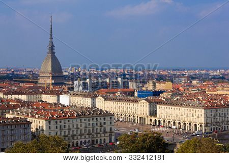 The view of Turin,Italy with  the symbol  monument the Mole Antonelliana  and a glimpse of square Vittorio Veneto with arched porticoes