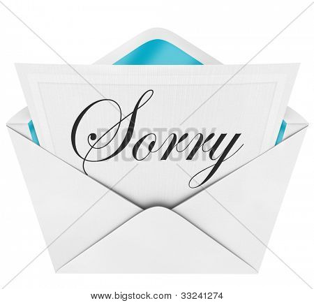 The handwritten, cursive word Sorry on an open envelope letter to express regret, concern, sympathy, remorse and sad feelings