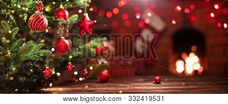Christmas Tree with Decorations Near a Fireplace with Lights