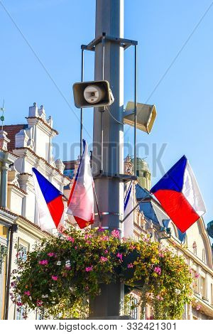 Czech flags waving on streets during the bank holiday. Historical buildings in the background. Freedom celebration. Fall of the communist regime in the Czech Republic. Bohemia, Moravia, and Silesia poster