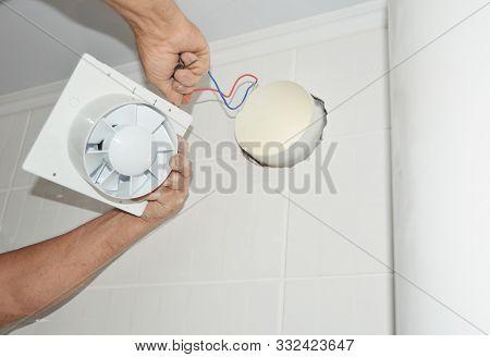 Handyman Installing New Bath Vent Fan, Ventilation System In The House Bathroom . Bath Fan Repair, I