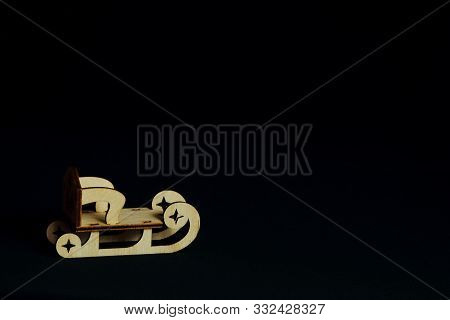 Stylized Original Wooden Sled For Decoupage On Black Background. Concept Christmas, Holiday, New Yea