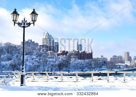 Winter Landscape Of The Dnipro City, Covered With Snow With A Beautiful Lantern.  View Of The Buildi