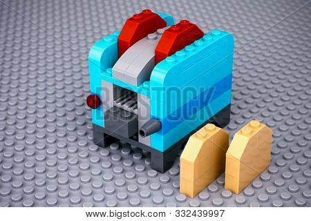 Tambov, Russian Federation - October 31, 2019 Blue Toaster Made By Lego Blocks On Gray Baseplate Bac