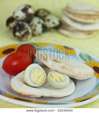 boiled quail egg accompanied by cherry tomatoes