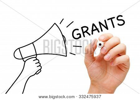 Hand Drawing A Megaphone Concept And Writing The Word Grants With Marker On Transparent Wipe Board I