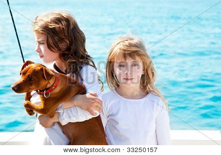 sister kid girls with dog mini pinscher on the sea view from a boat poster