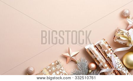 Beige Christmas Background With Festive Decorations, Baubles, Pine Tree Branches, Gifts, Wrapping Pa