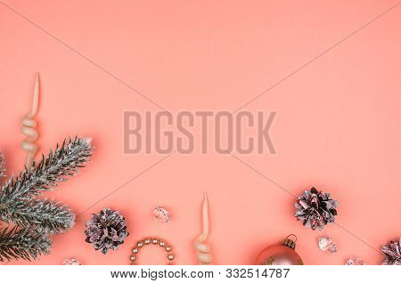 Snow Covered Christmas Tree Branch And Decorative Stones. Pink Cones, Christmas Ball, Pearls And Can