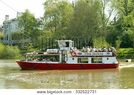 Chester, Cheshire, England, Uk, Europe - April 19, 2019 : Tourist Cruise Boat Traveling Along The Ri