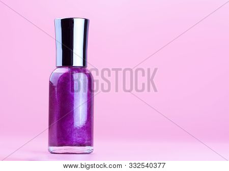 Bottle Of Purple Nail Polish On White Background