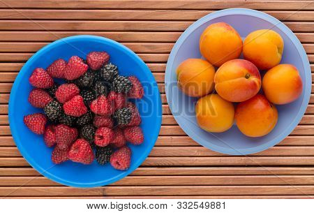 Fruits On A Blue Plate On A Orange Wooden Background .fruits On A Plate Top View.healthy Eating. Veg