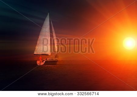 Sailing At Sunset. A View From The Yachts Deck To The Bow And Sails. Space For Teht