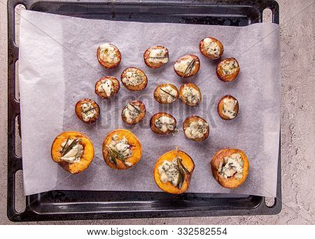 Preparation Grilled Baked Peach And Plums Stuffed With Blue Cheese Dorblu And Rosemary. Fruits Over