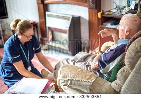 Andover,hampshire/united Kingdom-november 6 2019:a District Nurse Visits A Nineny Four Year Old Pati