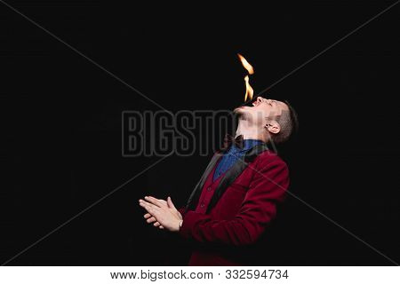Fire Show, Fakir Magician Swallows Burn And Puts Out Tongue In Mouth