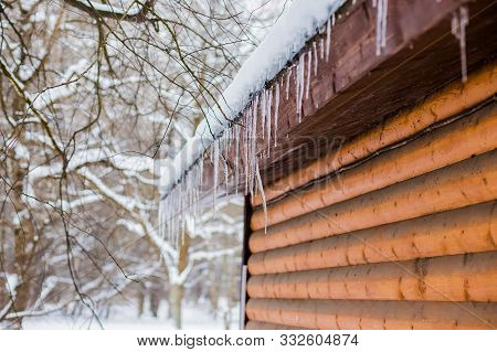 Frozen Mysterious Mansion With Water Pipe Gutters And Frozen Icicles On The Roof, Top Floor Wooden M