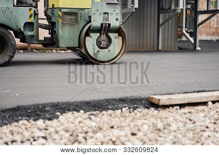 Asphalt Compactors Is Carrying Out Road Repair Work. Laying New Asphalt. Large Heavy Machinery. Cons