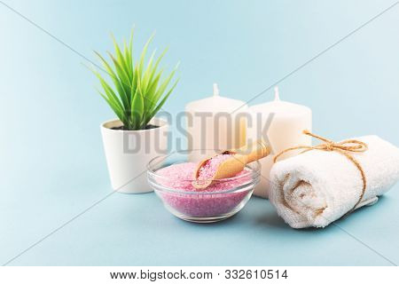 Beauty Composition With Pink Salt And Towel On Blue Background. Selfcare, Home Spa And Relaxation Co