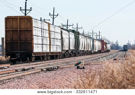 Loaded Railroad Cars On A Siding Waiting To Be Hauled West.