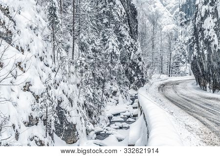 Wintery Snowcovered Mountain Road With White Snowy Spruces And Rocks. Wonderful Wintry Landscape. Tr